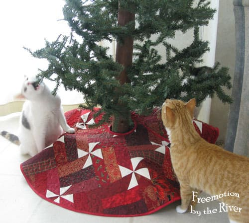 Cats checking out the Christmas tree