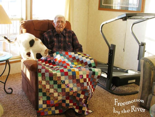 Dad with his Scrappy Trip Quilt