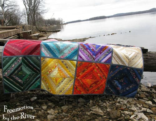 Rainbow Strings quilt by the river at Freemotion by the River