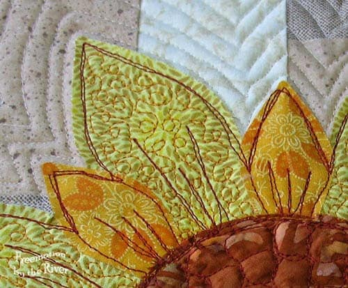 Closeup of quilting on a flower at Freemotion by the River