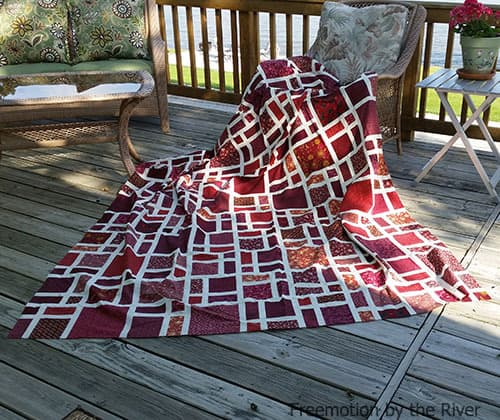 Scattered quilt in red fabrics