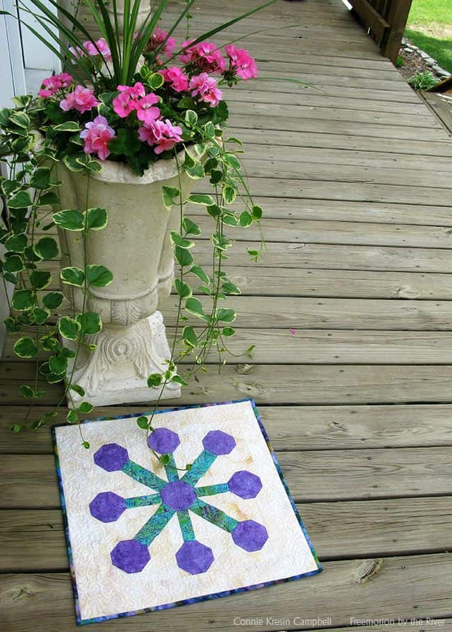 Beautiful batik table topper from the book Holiday Wishes by Sherri Falls