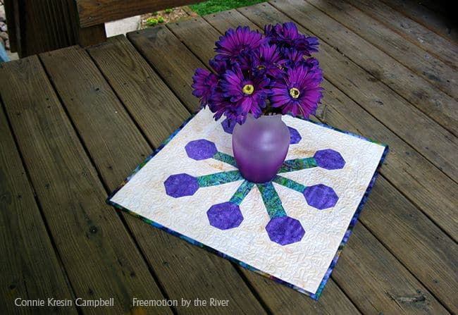Table topper with flowers on the deck