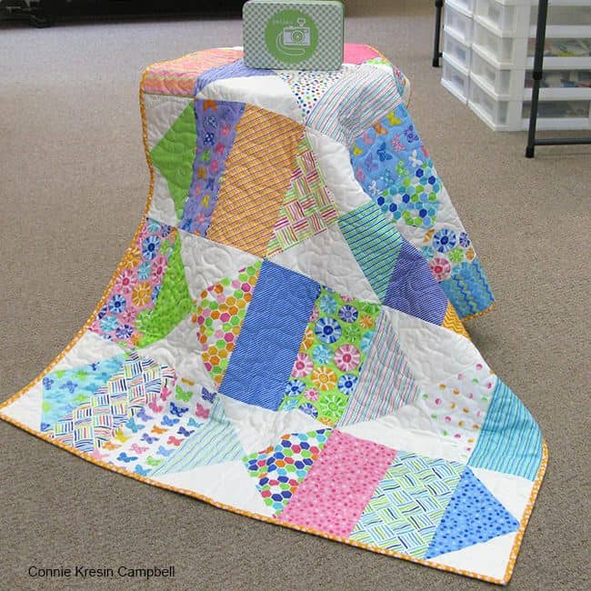 Birds Eye View baby quilt and a Tin