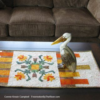 Applique table runner with a pelican