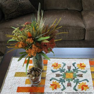 appliqued table runner for autumn design from Folk Art Quilted Traditions