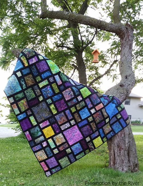 Scattered quilt on tree