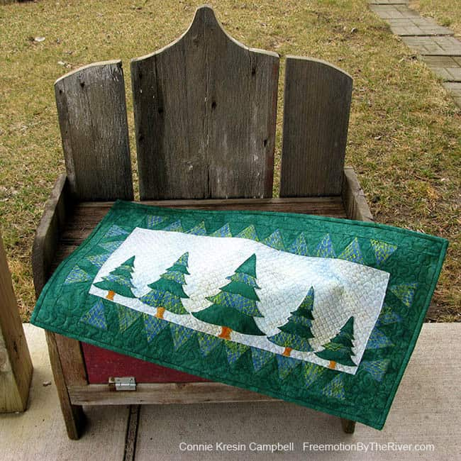 Evergreens wall hanging on a bench great gift