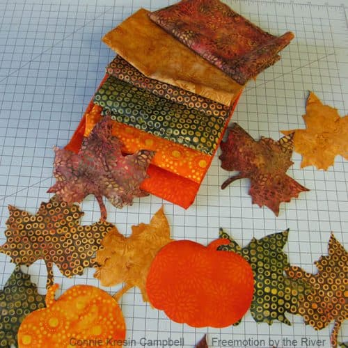 Pumpkins and leaves cut with AccuQuilt die