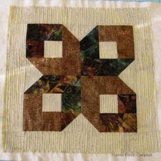 Brown Batik Box Pillow and Aurifil thread