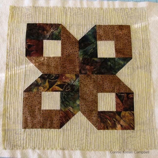 Brown Batik Box Pillow and Aurifil thread