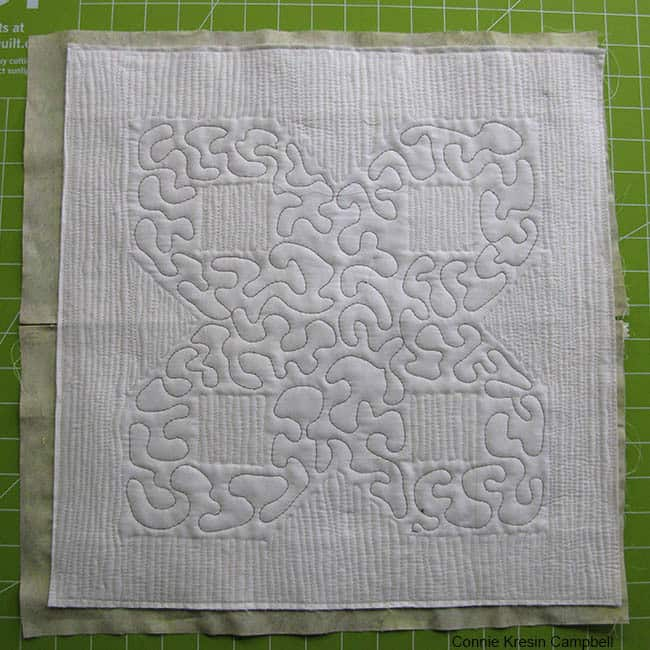 Stitch the pillow front and back together