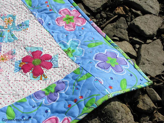 Twister Baby Quilt Tutorial border quilting