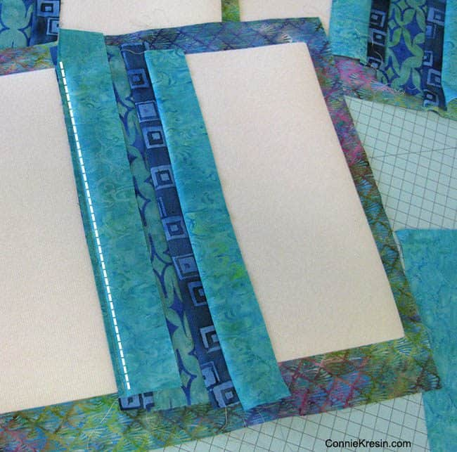 Batik QAYG placemats tutorial adding strips