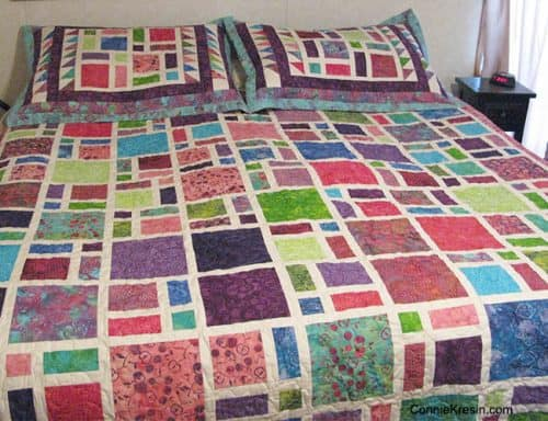 Scattered-Quilt-Pattern-Pillows-bed