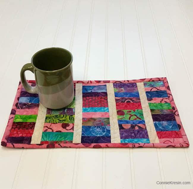 Island Batik mug rug in Cherry Berry